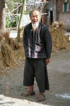 Jpeg 28K Old man - note his traditional sandals - in Black Miao village, Zuo Qi village, Min Gu township, Zhenfeng county, Guizhou province 0010q20.jpg