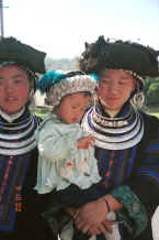 Jpeg 35K Black Miao young women with baby all in their festival finery, Zuo Qi village, Min Gu township, Zhenfeng county, Guizhou province 0010q22.jpg