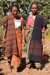 to 88K jpg Margareta Lolon (right) and Juliana Boy from Ili Api, with sarongs that they wove themselves. The red sarong on the left is used for wrapping elephant tusks given in bridewealth exchanges, while the dark blue sarong at right is worn by the bride's family members at weddings