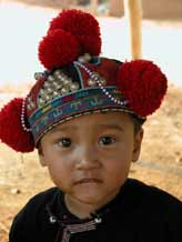 to Jpeg 40K Young Yao boy wearing a traditional style protective hat in a village near Chiang Rai  3240