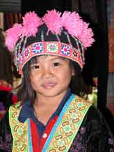to Jpeg 57K Young White Hmong girl in Ban Pha-nok-kok village dressed in her festival finery  3444