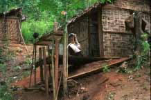 Jpeg 42K Padaung woman outside the back of her house 8823i22