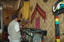 to 56K Jpg - Nick Fielding looking at some old weavings at the Aljamelah Inaul Weaving and Sewing Center - Mindanao, 2007