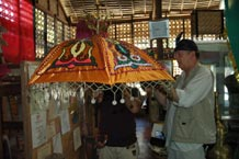 to Jpeg 60K Nick Fielding examining a locally made parasol at the Aljamelah Inaul Weaving and Sewing Center - Mindanao, 2007