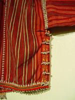 to 17 - Detail 2 of Gadang woman's cotton jacket, Paracelis Mountain Province, Northern Luzon, early 20th century. 108 cm (incl. sleeves) x 31 cm