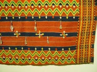 to 71K Jpg 18 - Detail 2 of Kalinga woman's cotton wrap-around skirt with beadwork and mother of pearl fragments, Apayo Province and parts of Abra Province, Northern Luzon, 20th century. 70 cm x 112 cm
