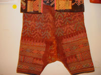 to 68K Jpg 20 - Detail 4 Bla'an man's abaka, cotton and embroidered jacket and trousers, Mindanao, 19th century. Jacket 145 cm x 58 cm x 41 cm, Trousers 43 cm x 53 cm