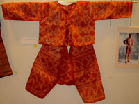 to 70K Jpg 21 - Bogobo man's abaka and plangi (tie-dye) jacket and trousers, Mindanao, early 20th century. Jacket 117 cm x 41 cm x 49 cm. Trousers 59 cm x 66 cm
