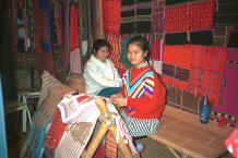 to Jpeg 37K Two Karen girls selling traditional hand-woven clothing in the night market in Chiang Mai in northern Thailand 8812i05.jpg