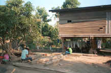 to Jpeg 42K Working on building timber at a Sgaw Karen village along the Mae Kok river between Tha Thon and Chiang Rai in northern Thailand 8812o31.jpg