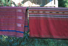 to Jpeg 30K Two hand woven sarongs of mainly koh (red) dyed cotton with additional ikat dyed and plain dyed stripes  8812o34.jpg