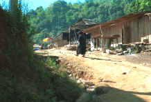to Jpeg 38K Yao old woman walking up into the village in the hills around Chiang Rai in Northern Thailand 8812q25.jpg