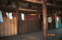 to Jpeg 31K Curtains separating off the sleeping areas from each other and from the living area in a Black Thai House.  Note the hand woven material in several curtain headings as well as patchwork.  Dien Bien Phu.  Lai Chau Province. 9510C36.JPG