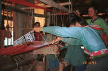 to Jpeg 30K Black Thai women demonstrating weaving on a length of weaving for bags and bedding/cushion ends in a village near Dien Bien Phu, Lai Chau Province 9510D18.JPG