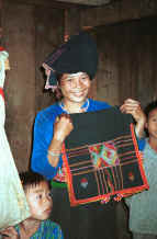 to Jpeg 30K Black Thai woman with an embroidered head cloth.  See notes to photo to the left of this one in the Photo gallery.  Dien Bien Phu, Lai Chau Province. 9510D22.JPG