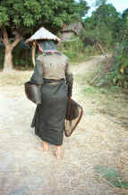 to Jpeg 40K Black Thai woman returning from fishing - she had maggots in her basket.  Dien Bien Phu, Lai Chau Province. 9510E29.JPG
