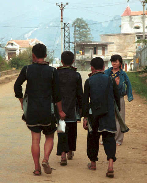 to Jpeg 31K Black Hmong young men walking home from Sa Pa, Lao Cai Province.  Note the various styles to wear the trousers! 9510I22.JPG