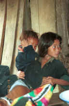 to Jpeg 33K Black Hmong girl looking after a young boy in the hills around Sa Pa, Lao Cai Province 9510J07.JPG
