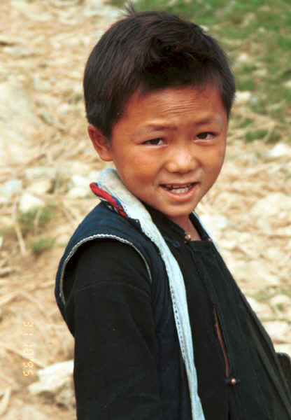 Jpeg 24K Black Hmong boy walking home from school in the hills around Sa Pa, Lao Cai Province 9510K11.JPG