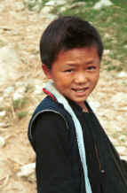 to Jpeg 24K Black Hmong boy walking home from school in the hills around Sa Pa, Lao Cai Province 9510K11.JPG