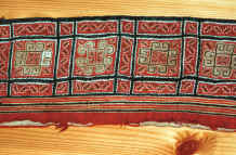 to Jpeg 53K The embroidered underside of a collar cut off a Black Hmong sleeveless jacket purchased from a Black Hmong woman in Sa Pa, Lao Cai Province 9511A25.JPG