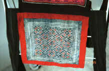to Jpeg 37K Batik, appliqué detail  from Black Hmong baby carrier collected in Sa pa, Northern Vietnam 9511a19