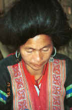 to Jpeg 30K Red Hmong woman in a village in Lai Chau province, northern Vietnam 9510f30.jpg