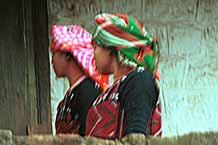to 63K Jpeg 9510I13a Two Phula, Xa Pho girls in Sa Pa, Lao Cai Province, north west Vietnam. Note the wool embroidery and Jacob's tear seeds on the blouses.