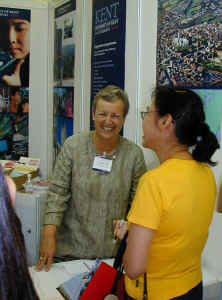 Pamela on the exhibition stand in Hong Kong promoting the University of Kent at Canterbury (UK) in August 2001